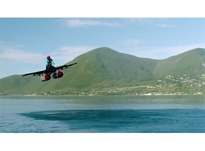 Watch a flying car prototype hover over a lake